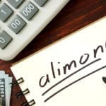 alimony lawyer - money and calculator on desk